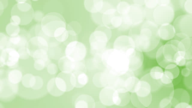 4k soft bokeh light on green background - two dimensional shape stock videos & royalty-free footage