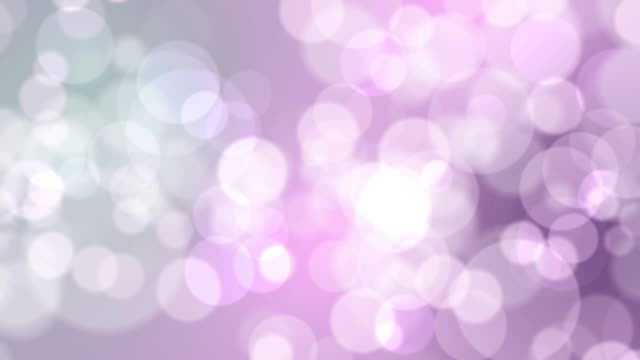 4k soft bokeh light on green blue pink background - purple stock videos & royalty-free footage