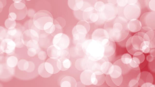 赤い背景に4kソフトボケライト - カラーグラデーション点の映像素材/bロール