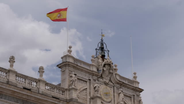 4k spain national flag flying in the wind atop the royal palace of madrid - courtyard stock videos & royalty-free footage