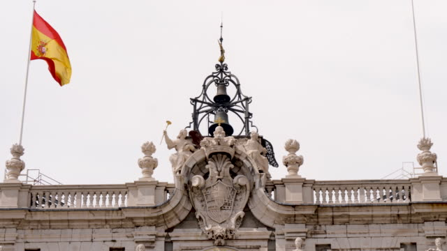 4k spain national flag flying in the wind atop the royal palace of madrid - spanish culture stock videos & royalty-free footage