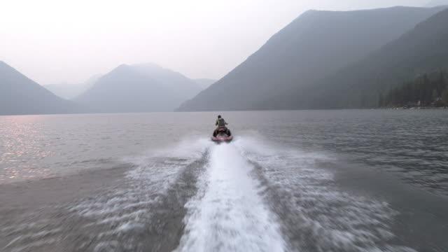 AERIAL 4k: Speeding Up the Shoreline on a Jet Ski