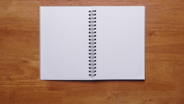 4k : stop motion of hand open notebook with blank page on wooden background - note pad stock videos & royalty-free footage