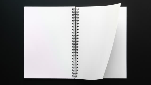 4k stop motion of  notebook open with blank page on black background - page stock videos & royalty-free footage