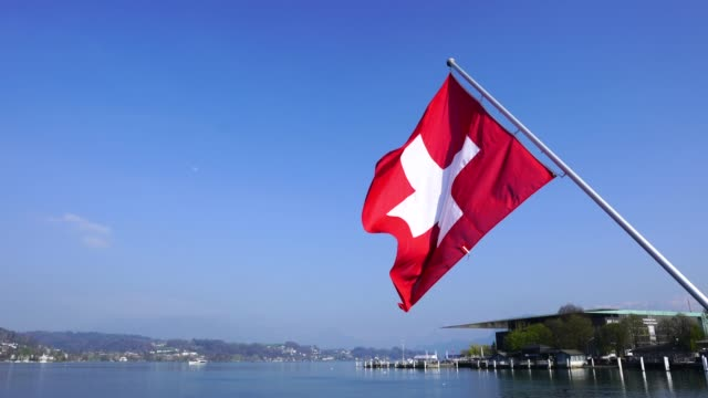 vídeos de stock e filmes b-roll de 4k swiss flag in luzern - switzerland