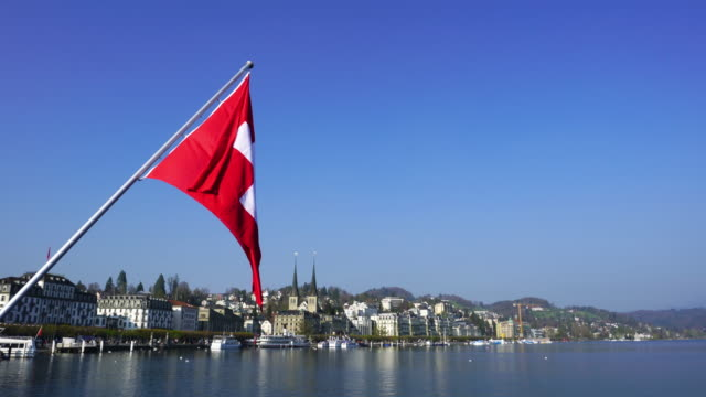 4k swiss flag in luzern - flag stock videos & royalty-free footage