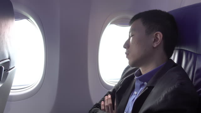 4k: take a nap on airplane - passenger stock videos & royalty-free footage