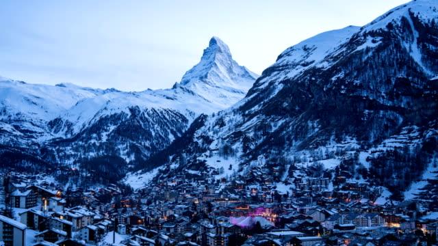4k time lapse : aerial view on zermatt village and matterhorn peak, switzerland - fast motion stock videos & royalty-free footage