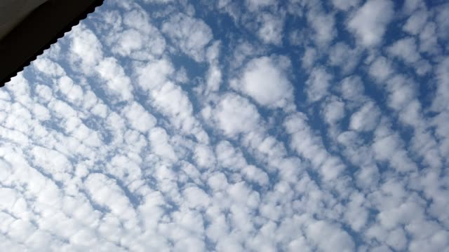 4k time lapse - clouds flying overhead - directly below stock videos & royalty-free footage