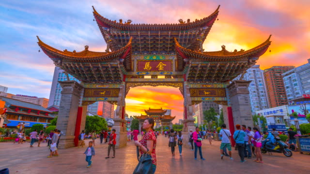 4k time lapse day to night scene of the archway, traditional piece of architecture and the emblem of the city of kunming in china. - arch architectural feature stock videos and b-roll footage
