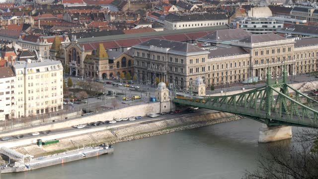 4k time lapse high angle aerial shot of city life and traffic including central market hall, corvinus university and liberty bridge in budapest hungary - széchenyi chain bridge stock videos & royalty-free footage