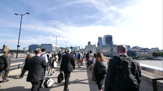 4k time lapse movement of businessman walking on london bridge, england, uk - commuter stock videos & royalty-free footage