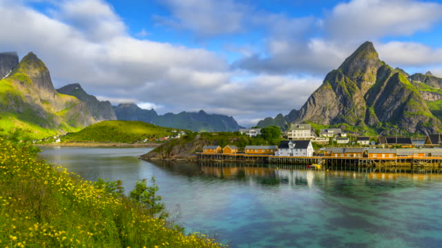 4k time lapse moving clouds over traditional norwegian fisherman's cabins, rorbuer, on the island of hamnoy, reine, lofoten islands, summer of norway. - traditionally norwegian stock videos & royalty-free footage