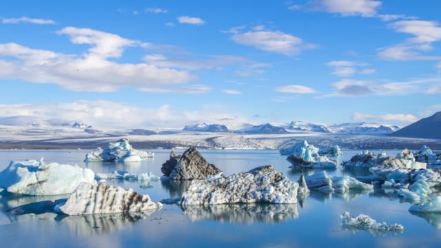4k Time lapse Moving of Cloud with Blue icebergs floating in Jokulsarlon glacial lagoon, Iceland