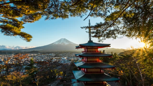 4k time lapse mt. fuji with red pagoda in winter, fujiyoshida, japan - giapponese video stock e b–roll