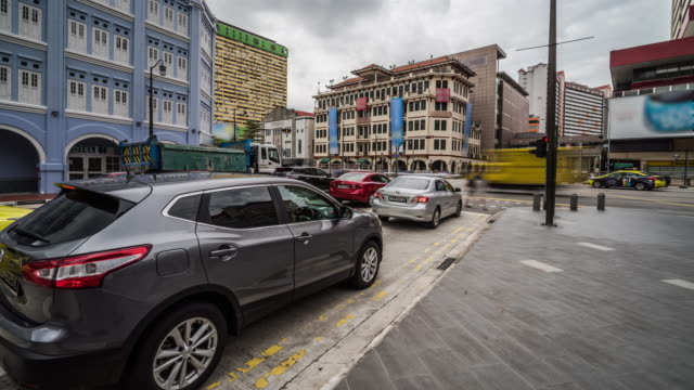 4k time lapse of busy traffic and  buildings in China town Singapore