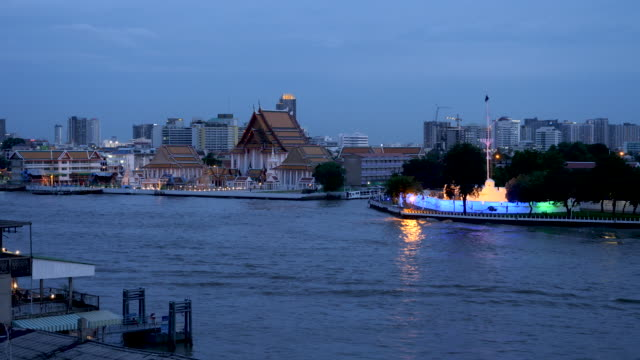 4k t/l time lapse of illunimated cruise ships and party boats sailing on the chao phraya river in bangkok thailand. tourists having fun and exploring the city - british military stock videos & royalty-free footage