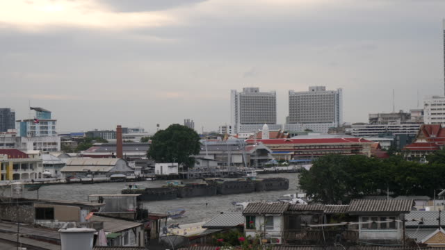 4k t/l time lapse of industrial commercial garbage boats sailing on the chao phraya river in bangkok thailand. rubbish collection disposal and recycling. - british military stock videos & royalty-free footage