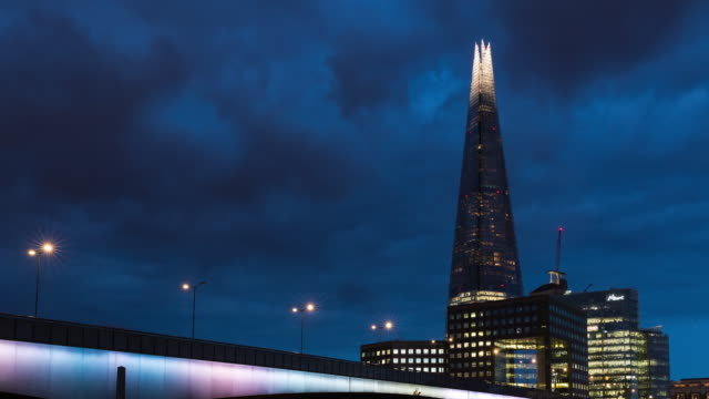 4k time lapse of london bridge and shard tower at night - vibrant color stock videos & royalty-free footage