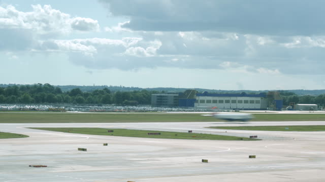 4k time lapse of london gatwick airport lgw runway showing aeroplanes taxiing queuing for take off and landing at busy congested airport. shows a variety of small, medium and large planes. - airplane hangar stock videos & royalty-free footage