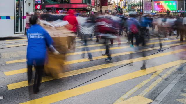 4k time lapse of people crossing street at Hongkong.
