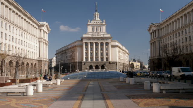 4k time lapse of the the former communist party house at the end of the independence square in sofia, bulgaria. - authority stock-videos und b-roll-filmmaterial