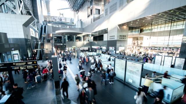 4k Time lapse :  Passengers at station in kyoto, Japan, Tild Down Shot