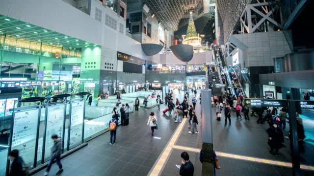 4k Time lapse :  Passengers at station in kyoto, Japan, Tilt Up Shot