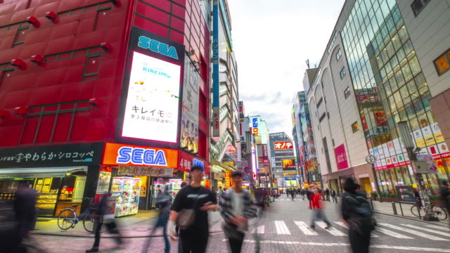 4k time lapse : pedestrians crowded shopping akihabara electric town tokyo at twilight - akihabara stock videos and b-roll footage
