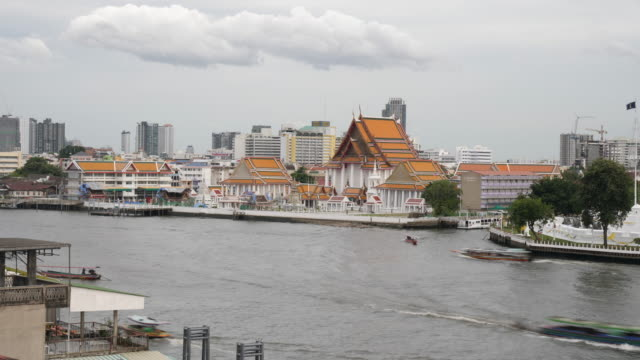 4k t/l time lapse river scenic boats, commercial ships and river taxis sailing on the chao phraya river in bangkok thailand. everyday city life on the rivers of bangkok - british military stock videos & royalty-free footage