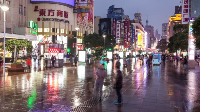 4k, Time Lapse , Shanghai Nanjing Road Pedestrian Street cityscape , night rain shuttle crowd