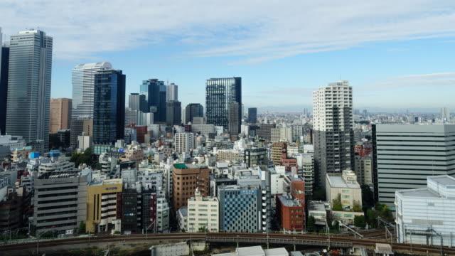 4k Time Lapse Skyline City With Blue Sky At Shinjuku Tokyojapan