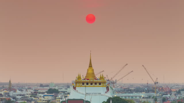 4k time lapse : sunset golden temple in center city of bangkok thailand - buddha stock videos and b-roll footage