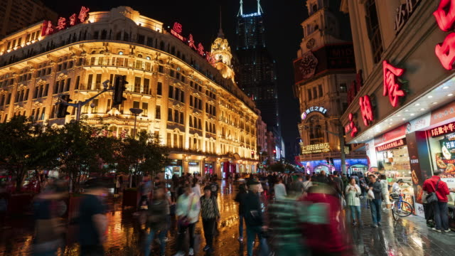 4k time lapse: tourist pedestrian crowd walking at nanjing road shopping street at night before national holiday, shanghai city, china. - chinese flag stock videos & royalty-free footage