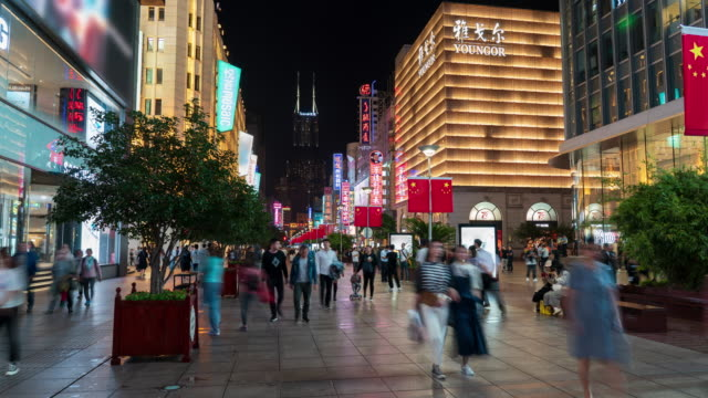 4k time lapse: tourist pedestrian crowd walking at nanjing road shopping street at night before national holiday, shanghai city, china. - nanjing stock videos & royalty-free footage