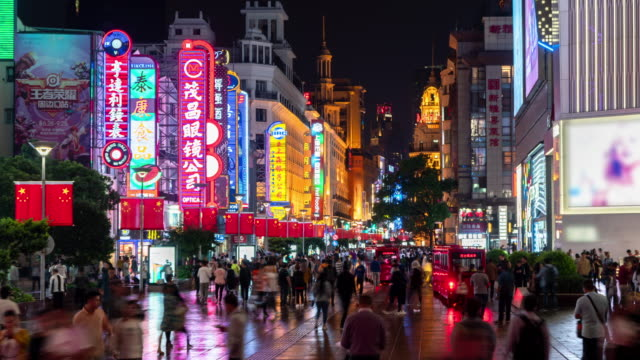 4k time lapse: tourist pedestrian crowd walking at nanjing road shopping street which decorated with chinese flag, shanghai city, china. - anniversary stock videos & royalty-free footage