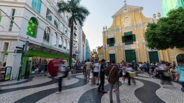 4k time lapse: tourists walking in front of st. dominic's church, macao. - traditionally portuguese stock videos & royalty-free footage