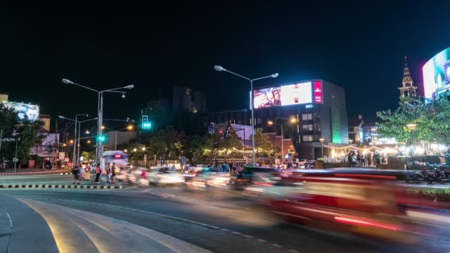 4k time lapse: traffic intersection at night in chiang mai, thailand - chiang mai city stock videos and b-roll footage