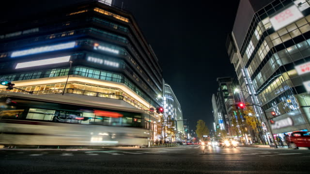 4k Time lapse : Traffic speeds through an intersection in Kyoto City. Zoom In Shot