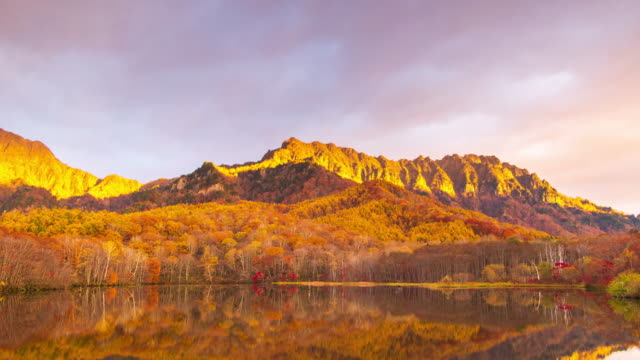 4k time lapse with tilt down of kagamiike pond in autumn season, nagano, japan. - high dynamic range imaging stock videos and b-roll footage