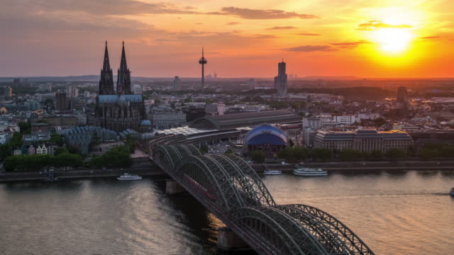 4k timelapse : aerial cologne cathedral hohenzollern bridge at sunset, germany - north rhine westphalia stock videos & royalty-free footage