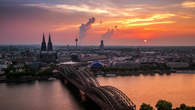 4k timelapse : aerial cologne cathedral hohenzollern bridge at sunset, germany - bridge built structure stock videos & royalty-free footage