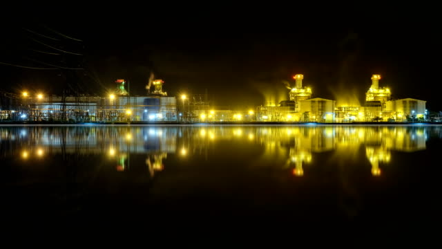4k timelapse at night of combined cycle powerplant - gas pipe stock videos and b-roll footage