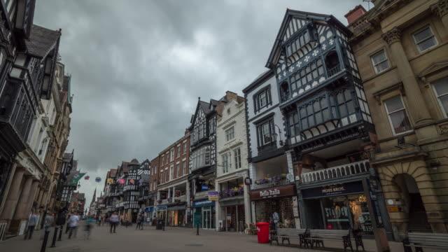 4k time-lapse : chester bridge street, high street shops und shopper - chester cheshire stock-videos und b-roll-filmmaterial