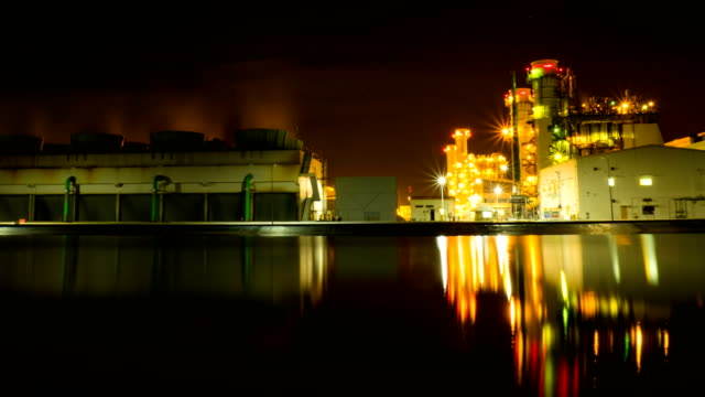 4k timelapse combined cycle power plant at night - generator stock videos & royalty-free footage