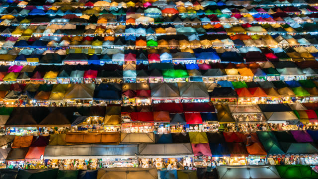 4k timelapse day to night aerial view of bangkok night market in bangkok city downtown with sunset sky and clouds at bangkok , thailand. and colourful tents - admiration stock videos and b-roll footage