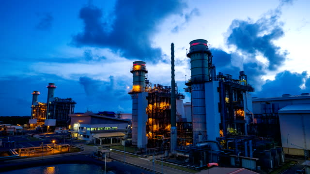 4k timelapse day to night of combined cycle powerplant - power station stock videos & royalty-free footage
