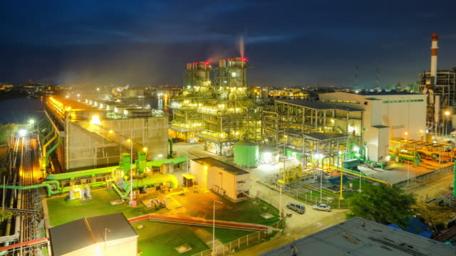 4k timelapse day to night of combined cycle powerplant with cooling tower near river at south east asia - tubo video stock e b–roll