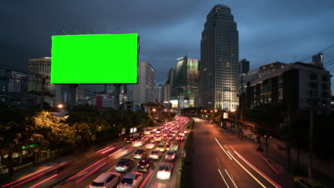 4k timelapse day to night of light trails in road to asoke district at the center of heart business district in bangkok city downtown thailand - advertisement stock videos & royalty-free footage