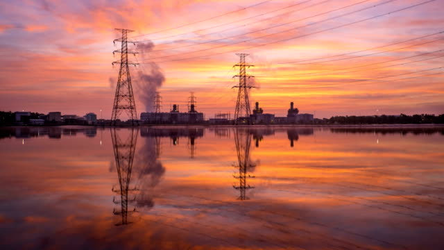 4k timelapse in sunrise of combined cycle powerplant - gas pipe stock videos and b-roll footage